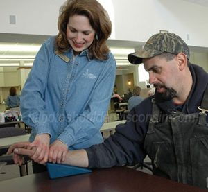 Wrist exercises are performed by a licensed therapist